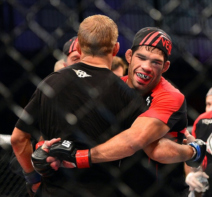 Raphael Assuncao hugging opponent TJ Dillashaw after his split decision win. Credit: Jason Silva-USA TODAY Sports