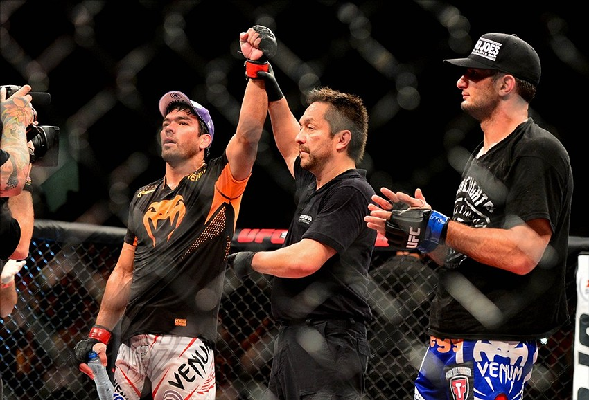Feb 15, 2014; Jaragua do Sul, SC, Brazil; Lyoto Machida (red gloves) after defeating Gegard Mousasi (blue gloves) during UFC Fight Night Machida vs Mousasi at Arena Jaragua. Mandatory Credit: Jason Silva-USA TODAY Sports