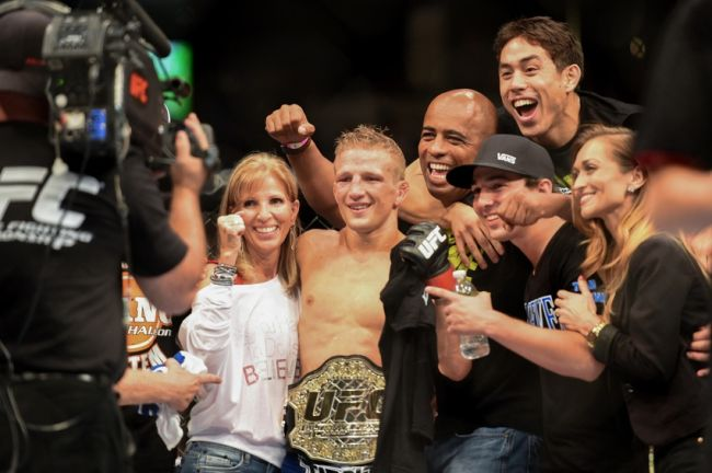 August 30, 2014; Sacramento, CA, USA; T.J. Dillashaw poses for a photo with his title belt after defeating Joe Soto (not pictured) during the bantamweight title bout of UFC 177 at Sleep Train Arena. Mandatory Credit: Kyle Terada-USA TODAY Sports