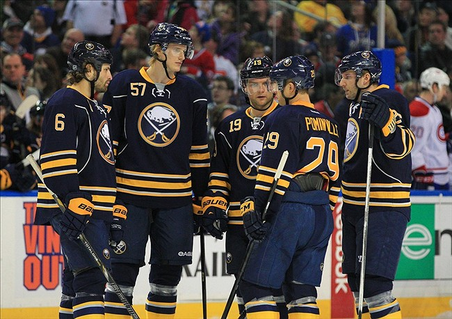 Feb 7, 2013; Buffalo, NY, USA; the Buffalo Sabres sabres line with defenseman Mike Weber (6), defenseman Tyler Myers (57), center Cody Hodgson (19), and left wing Thomas Vanek (26) during the game against the Montreal Canadiens at the First Niagara Center. Mandatory Credit: Kevin Hoffman-USA TODAY Sports