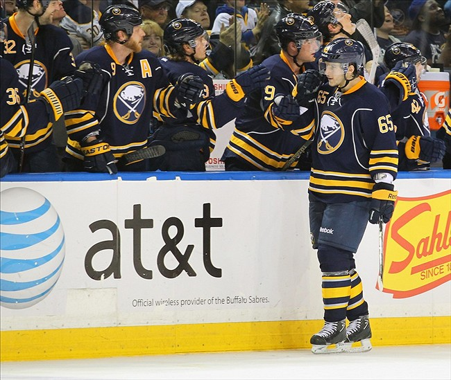 Apr. 5, 2013; Buffalo, NY, USA; Buffalo Sabres right wing Brian Flynn (65) celebrates his third period goal with teammates against the Ottawa Senators at First Niagara Center. Sabres beat Ottawa 4 to 2. Mandatory Credit: Timothy T. Ludwig-USA TODAY Sports