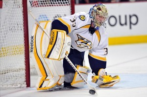 Apr 19, 2013; Chicago, IL, USA; Nashville Predators goalie Pekka Rinne (35) plays the puck against the Chicago Blackhawks during the third period at the United Center. The Blackhawks beat the Predators 5-4 in overtime. Mandatory Credit: Rob Grabowski-USA TODAY Sports