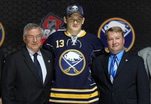 Jun 30, 2013; Newark, NJ, USA; Nikita Zadorov poses for a photo as he is introduced as the number sixteen overall pick to the Buffalo Sabres during the 2013 NHL Draft at the Prudential Center. Mandatory Credit: Ed Mulholland-USA TODAY Sports