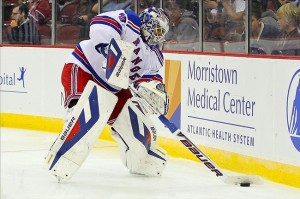 Sep 16, 2013; Newark, NJ, USA; New York Rangers goalie Henrik Lundqvist (30) passes the puck during the second period of their game against the New Jersey Devils at Prudential Center. Mandatory Credit: Ed Mulholland-USA TODAY Sports