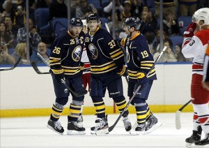 Sep 19, 2013; Buffalo, NY, USA; Buffalo Sabres center Cody Hodgson (19) celebrates his goal against the Carolina Hurricanes with left wing Thomas Vanek (26) and right wing Joel Armia (33) during the third period at First Niagara Center. Sabres beat the Hurricanes 5-2. Mandatory Credit: Kevin Hoffman-USA TODAY Sports
