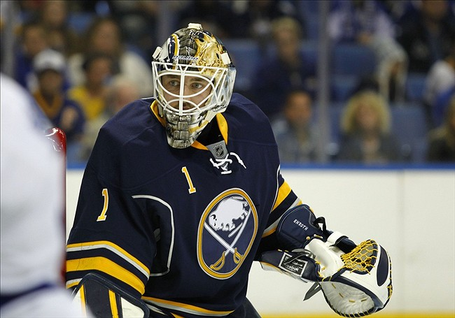 Sep 21, 2013; Buffalo, NY, USA; Buffalo Sabres goalie Jhonas Enroth (1) looks for the puck behind the net during the first period against the Toronto Maple Leafs at First Niagara Center. Mandatory Credit: Timothy T. Ludwig-USA TODAY Sports