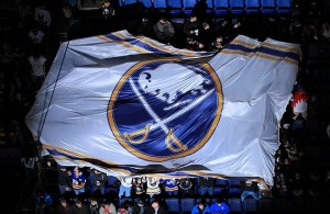 Apr 5, 2013; Buffalo, NY, USA; Buffalo Sabres fans move a flag around the center before the game between the Buffalo Sabres and the Ottawa Senators at the First Niagara Center. Sabres beat the Senators 4-2. Mandatory Credit: Kevin Hoffman-USA TODAY Sports
