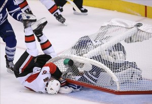 Oct 5, 2013; Toronto, Ontario, CAN; Ottawa Senators right wing Bobby Ryan (6) tumbles over the net landing on Toronto Maple Leafs goalie Jonathan Bernier (45) at the Air Canada Centre. The Maple Leafs beat teh Senators 5-4 in the shootout. Mandatory Credit: Tom Szczerbowski-USA TODAY Sports
