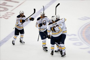 Oct 15, 2013; Uniondale, NY, USA; Buffalo Sabres left wing Marcus Foligno (82) celebrates scoring the tying goal during the third period against the New York Islanders at Nassau Veterans Memorial Coliseum. Buffalo won 4-3 in shootout. Mandatory Credit: Anthony Gruppuso-USA TODAY Sports