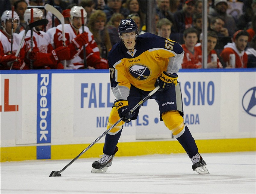 Nov 24, 2013; Buffalo, NY, USA; Buffalo Sabres defenseman Tyler Myers (57) looks to make a pass during the second period against the Detroit Red Wings at First Niagara Center. Mandatory Credit: Timothy T. Ludwig-USA TODAY Sports