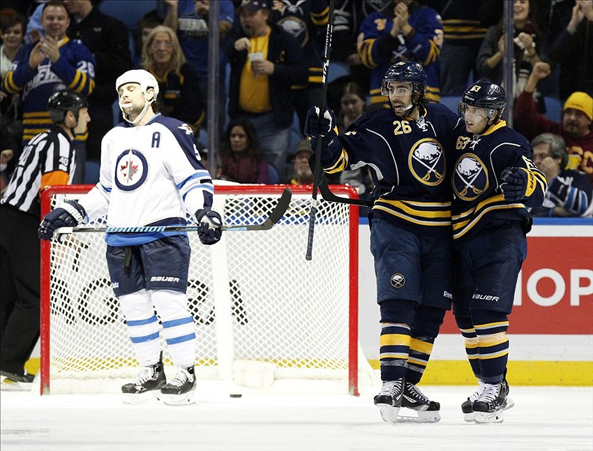 Dec 17, 2013; Buffalo, NY, USA; Buffalo Sabres left wing Matt Moulson (26) celebrates his goal against the Winnipeg Jets with left wing Tyler Ennis (63) during the third period at First Niagara Center. Sabres beat the Jets 4-2. Mandatory Credit: Kevin Hoffman-USA TODAY Sports