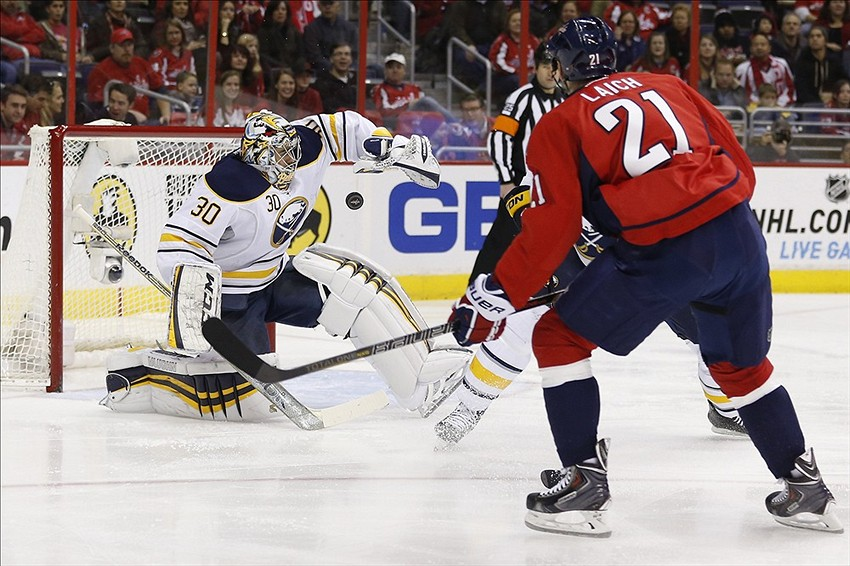 Jan 12, 2014; Washington, DC, USA; Buffalo Sabres goalie Ryan Miller (30) makes a save in front of Washington Capitals center Brooks Laich (21) in the first period at Verizon Center. Mandatory Credit: Geoff Burke-USA TODAY Sports