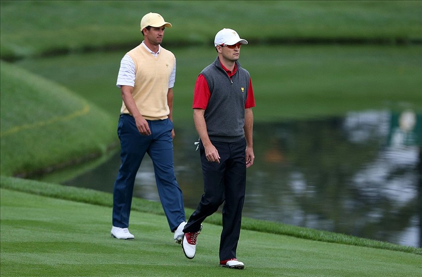 Oct 5, 2013; Dublin, OH, USA; Adam Scott and Zach Johnson walk up to the 16th green during the second round of the Presidents Cup at Muirfield Village Golf Club. Mandatory Credit: Brian Spurlock-USA TODAY Sports