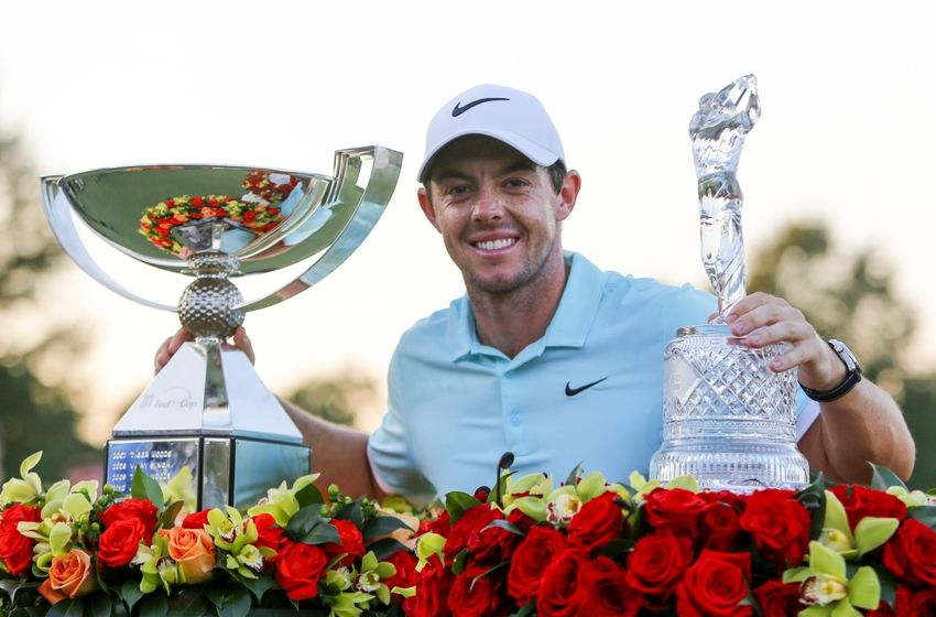 Sep 25, 2016; Atlanta, GA, USA; Rory McIlroy celebrates with the FedEx Cup Trophy and the Tour Championship Trophy after the final playoff round of the Tour Championship at East Lake Golf Club. Mandatory Credit: Butch Dill-USA TODAY Sports