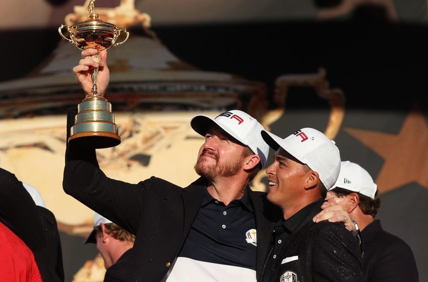 Oct 2, 2016; Chaska, MN, USA; Jimmy Walker of the United States and Rickie Fowler of the United States celebrate with the Ryder Cup during the closing ceremonies after the single matches in 41st Ryder Cup at Hazeltine National Golf Club. Mandatory Credit: Rob Schumacher-USA TODAY Sports