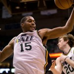 Apr 5, 2013; Salt Lake City, UT, USA; Utah Jazz power forward Derrick Favors (15) grabs a rebound during the second half against the New Orleans Hornets at EnergySolutions Arena. The Jazz won 95-83. Mandatory Credit: Russ Isabella-USA TODAY Sports