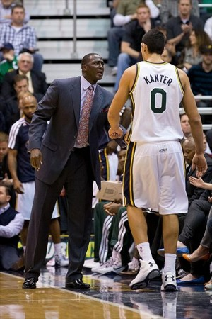 November 19, 2012; Salt Lake City, UT, USA; Utah Jazz head coach Tyrone Corbin talks to center Enes Kanter (0) as Kanter leaves the floor during the first half against the Houston Rockets at EnergySolutions Arena. Mandatory Credit: Russ Isabella-USA TODAY Sports