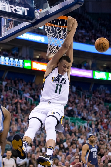 Nov 14, 2016; Salt Lake City, UT, USA; Utah Jazz guard Dante Exum (11) hangs from the rim after being fouled going up for a dunk during the second half against the Memphis Grizzlies at Vivint Smart Home Arena. Memphis won 102-96. Mandatory Credit: Russ Isabella-USA TODAY Sports