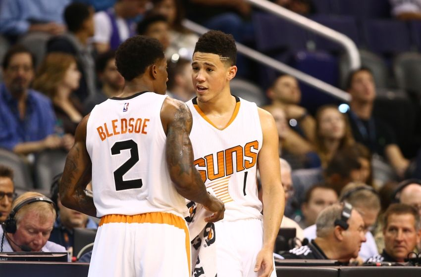 Nov 27, 2016; Phoenix, AZ, USA; Phoenix Suns guard Devin Booker (right) and teammate Eric Bledsoe talk in the second half against the Denver Nuggets at Talking Stick Resort Arena. The Nuggets defeated the Suns 118-114. Mandatory Credit: Mark J. Rebilas-USA TODAY Sports