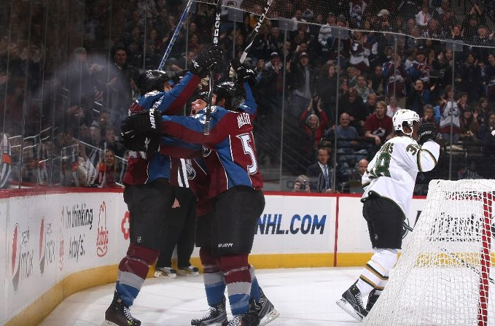 Chris Durno #45 of the Avalanche celebrates his first NHL goal with teammates against the Stars on December 26