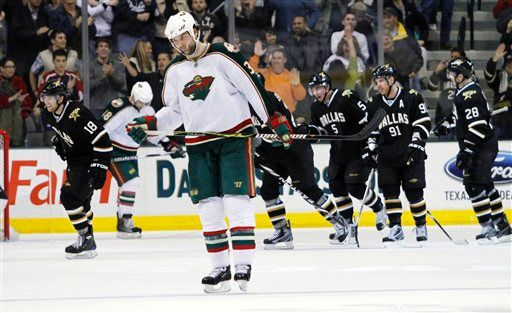 Zidlicky (3), skates back as the Stars celebrate defender Matt Niskanen's goal in the 2nd (AP Photo/Tim Sharp)