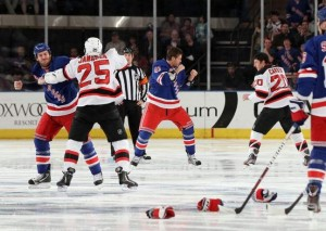 (PHOTO: JIM MCISAAC / MCCLATCHEY NEWS SERVICE) New York Rangers' Brandon Prust (left) fights New Jersey Devils' Cam Janssen and Rangers'Stu Bickel (41) dukes it out with Ryan Carter (20) of the Devils three seconds into the game at Madison Square Garden in New York.