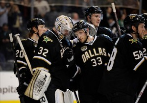Mar 3, 2013; Dallas, TX, USA; Dallas Stars goalie Kari Lehtonen (32) and defenseman Alex Goligoski (33) celebrate the win over the St. Louis Blues at the American Airlines Center. The Stars defeated the Blues 4-1. Mandatory Credit: Jerome Miron-USA TODAY Sports