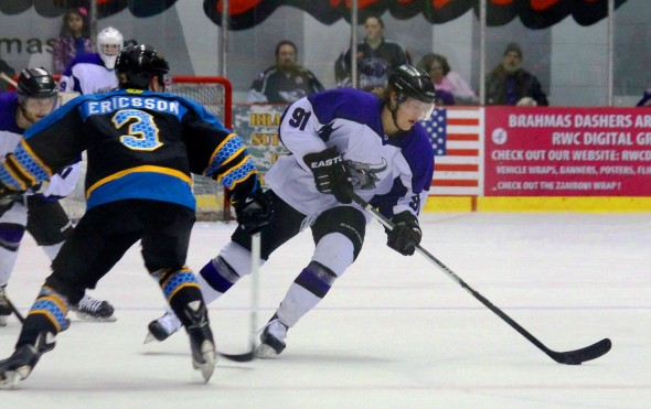 Photo Courtesy of David Dudich: #91 Liam Stirtzinger moves the puck up ice against the Rio Grande Killer Bees. Stirtzinger's shootout goal gave the Brahmas a big win heading into the Christmas break.