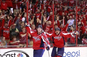 Apr 23, 2013; Washington, DC, USA; Washington Capitals left wing Alex Ovechkin (8) and Capitals center Nicklas Backstrom (19) celebrate after scoring a goal against the Winnipeg Jets in the second period at Verizon Center. Mandatory Credit: Geoff Burke-USA TODAY Sports