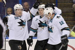 Oct 15, 2013; St. Louis, MO, USA; San Jose Sharks center Logan Couture (39) is congratulated by teammates after scoring a goal against the St. Louis Blues during the first period at Scottrade Center. Mandatory Credit: Jasen Vinlove-USA TODAY Sports