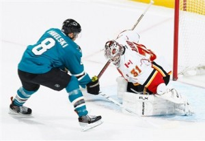 San Jose Sharks' Joe Pavelski (8) attempts to score on Calgary goalie Karri Ramo in San Jose's 6-3 win Saturday Night. Mandatory Credit: Don Smith NHLI