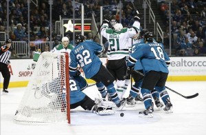 Dec 21, 2013; San Jose, CA, USA; Dallas Stars left wing Antoine Roussel (21) scores a back handed goal during the second period against San Jose Sharks goalie Alex Stalock (32) at SAP Center at San Jose. Mandatory Credit: Bob Stanton-USA TODAY Sports