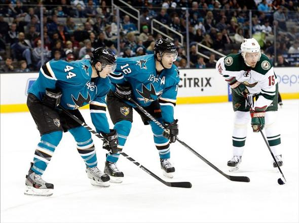 Jan 25, 2014; San Jose, CA, USA; San Jose Sharks defenseman Marc-Edouard Vlasic (44), center Patrick Marleau (12) and Minnesota Wild left wing Dany Heatley (15) during a face off in the second period at SAP Center at San Jose. Sharks won 3 to 2 in overtime. Mandatory Credit: Bob Stanton-USA TODAY Sports