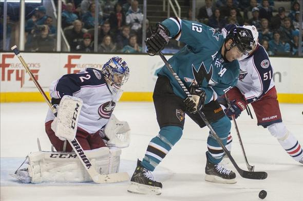 Feb 7, 2014; San Jose, CA, USA; San Jose Sharks center Patrick Marleau (12) shoots the puck against Columbus Blue Jackets goalie Sergei Bobrovsky (72) during the third period at SAP Center at San Jose. The Sharks won 3-2. Mandatory Credit: Ed Szczepanski-USA TODAY Sports