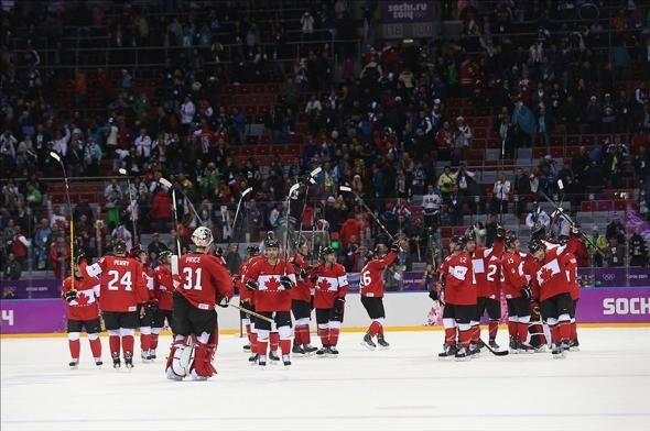 Team Canada celebrates a Gold Medal victory at the 2014 Sochi Olympics. Mandatory Credit: USA Today Sports Images