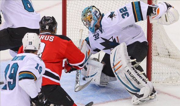 Mar 2, 2014; Newark, NJ, USA; San Jose Sharks goalie Alex Stalock (32) makes a save against the New Jersey Devils during the third period at Prudential Center. The Sharks won 4-2. Mandatory Credit: Ed Mulholland-USA TODAY Sports
