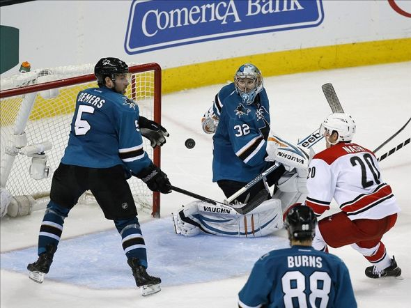 Mar 4, 2014; San Jose, CA, USA; San Jose Sharks defenseman Jason Demers (5) blocks a shot from Carolina Hurricanes center Riley Nash (20) as San Jose Sharks goalie Alex Stalock (32) watches during the third period at SAP Center at San Jose. Hurricanes won 3-2 in overtime. Mandatory Credit: Bob Stanton-USA TODAY Sports