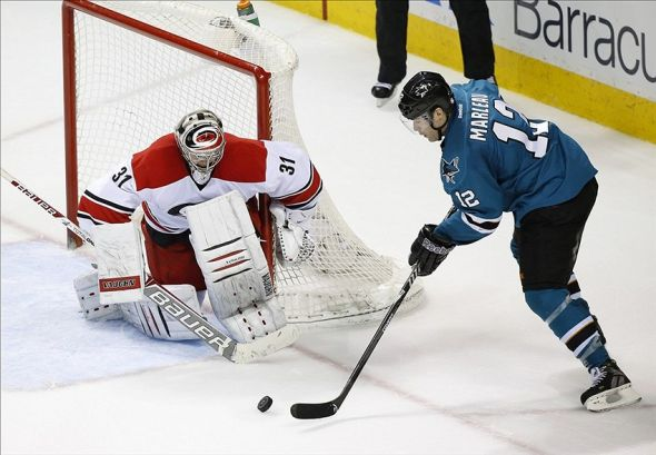 Mar 4, 2014; San Jose, CA, USA; at SAP Center at San Jose. San Jose Sharks winger Patrick Marleau (12) attempts to score on Carolinal Hurricanes goalie Anton Khudobin (31) during the overtime period at SAP Pavilion. Hurricanes won 3-2 in overtime. Mandatory Credit: Bob Stanton-USA TODAY Sports