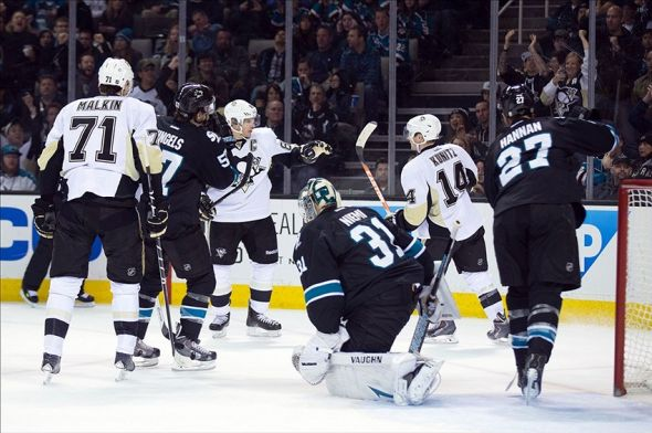 Mar 6, 2014; San Jose, CA, USA; Pittsburgh Penguins left wing Chris Kunitz (14) celebrates after scoring a goal against San Jose Sharks goalie Antti Niemi (31) during the first period at SAP Center at San Jose. Mandatory Credit: Kelley L Cox-USA TODAY Sports