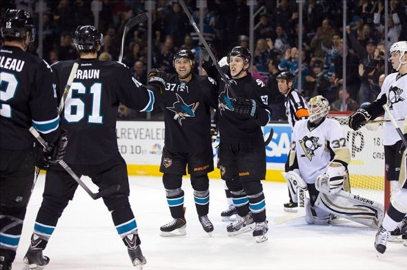 Mar 6, 2014; San Jose, CA, USA; San Jose Sharks right wing Adam Burish (37) celebrates with center Tommy Wingels (57), defenseman Justin Braun (61) and center Patrick Marleau (12) after scoring a goal against Pittsburgh Penguins goalie Jeff Zatkoff (37) during the second period at SAP Center at San Jose. Mandatory Credit: Kelley L Cox-USA TODAY Sports