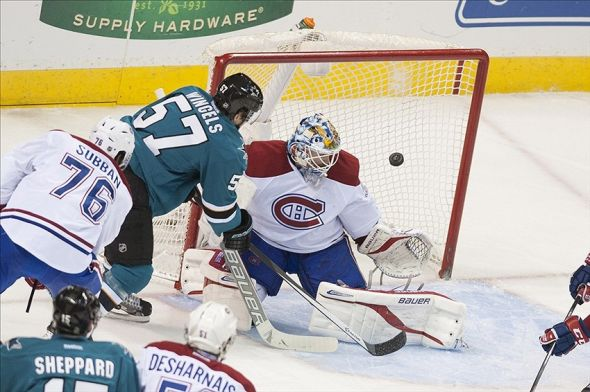 Mar 8, 2014; San Jose, CA, USA; Montreal Canadiens goalie Peter Budaj (30) makes a save on a shot by San Jose Sharks center Tommy Wingels (57) during the second period at SAP Center at San Jose. Mandatory Credit: Ed Szczepanski-USA TODAY Sports