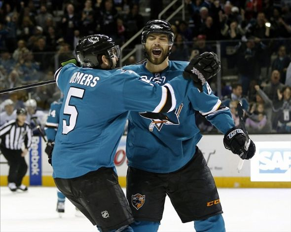 Mar 11, 2014; San Jose, CA, USA; San Jose Sharks right wing Brent Burns (88) celebrates with San Jose Sharks defenseman Jason Demers (5) after Burns scored during the first period against the Toronto Maple Leafs at SAP Center at San Jose. Mandatory Credit: Bob Stanton-USA TODAY Sports