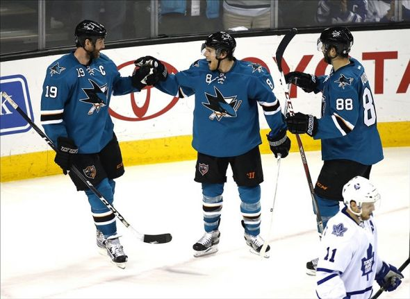Mar 11, 2014; San Jose, CA, USA; San Jose Sharks center Joe Pavelski (8) celebrates with Sharks center Joe Thornton (19) and Sharks right wing Brent Burns (88) after Pavelski scored with an assist from Thornton during the second period against the Toronto Maple Leafs at SAP Center at San Jose. Mandatory Credit: Bob Stanton-USA TODAY Sports