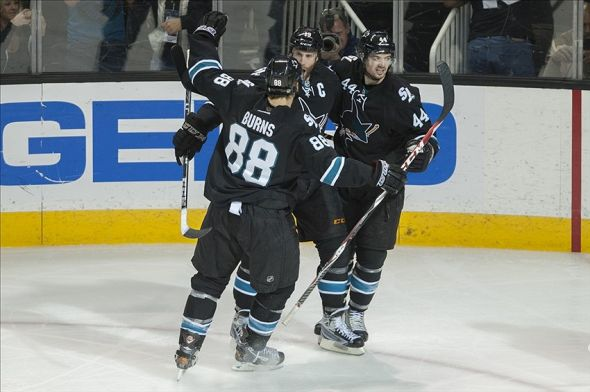 Mar 20, 2014; San Jose, CA, USA; San Jose Sharks center Joe Thornton (19) celebrates with right wing Brent Burns (88) and defenseman Marc-Edouard Vlasic (44) after scoring a goal against the Anaheim Ducks during the third period at SAP Center at San Jose. The Sharks won 3-2. Mandatory Credit: Ed Szczepanski-USA TODAY Sports