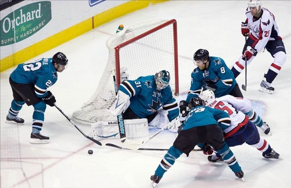 Mar 22, 2014; San Jose, CA, USA; San Jose Sharks goalie Antti Niemi (31) defends the goal against the Washington Capitals during the third period at SAP Center at San Jose. The Washington Capitals defeated the San Jose Sharks 3-2 in an overtime shootout. Mandatory Credit: Kelley L Cox-USA TODAY Sports