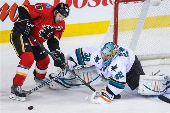 Mar 24, 2014; Calgary, Alberta, CAN; San Jose Sharks goalie Alex Stalock (32) makes a save as Calgary Flames left wing Curtis Glencross (20) tries to score during the third period at Scotiabank Saddledome. Calgary Flames won 2-1 in the shootout. Mandatory Credit: Sergei Belski-USA TODAY Sports