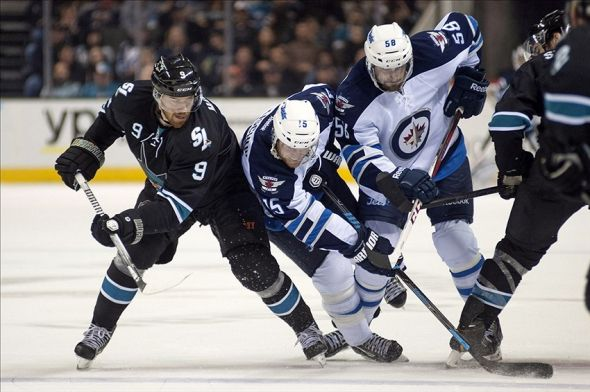 Mar 27, 2014; San Jose, CA, USA; San Jose Sharks right wing Martin Havlat (9) attempts to control the puck against Winnipeg Jets right wing Matt Halischuk (15) and center Eric O