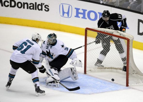 Apr 24, 2014; Los Angeles, CA, USA; Los Angeles Kings right wing Justin Williams (14) scores a goal on San Jose Sharks goalie Antti Niemi (31) during the second period in game four of the first round of the 2014 Stanley Cup Playoffs at Staples Center. Mandatory Credit: Kelvin Kuo-USA TODAY Sports