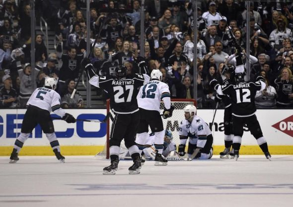 Apr 28, 2014; Los Angeles, CA, USA; Los Angeles Kings celebrate after a goal by center Anze Kopitar (11) against the San Jose Sharks during the third period in game six of the first round of the 2014 Stanley Cup Playoffs at Staples Center. The Los Angeles Kings won 4-1. Mandatory Credit: Kelvin Kuo-USA TODAY Sports