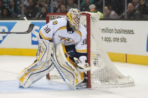 Apr 5, 2014; San Jose, CA, USA; Nashville Predators goalie Carter Hutton (30) defends against the San Jose Sharks during the second period at SAP Center at San Jose. The Nashville Predators defeated the San Jose Sharks 3-0. Mandatory Credit: Ed Szczepanski-USA TODAY Sports